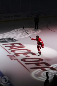 Red Wings captain Henrik Zetterberg salutes the Joe Louis Arena crowd during the pregame introductions at Joe Louis Arena to kick off the 2013-14 season. (Michael Caples/MiHockey)
