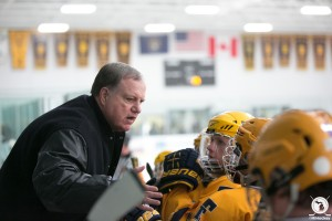 Trenton coach Mike Turner talks to his players during the game that saw him match the all-time wins total. (Photo by Andrew Knapik/MiHockey)