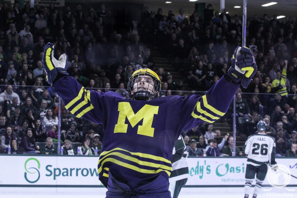 Travis Lynch celebrates his third-period game-winning goal for the Michigan Wolverines. (Photo by Michael Caples/MiHockey)