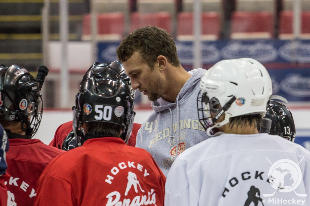 Luke Glendening signing autographs at the Red Wings Youth Camp Tuesday afternoon in Detroit. (Photo by Michael Caples/MiHockey)