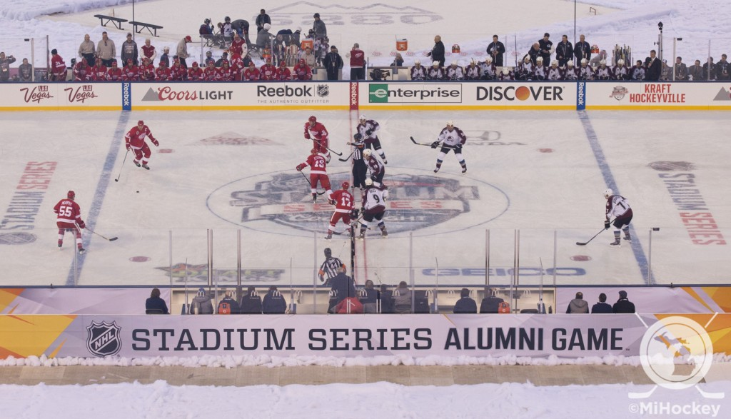 Steve Yzerman and Joe Sakic take the opening face-off for the Red Wings vs. Avalanche alumni game at Coors Field in Denver. (Photo by Erik Roush/MiHockey)