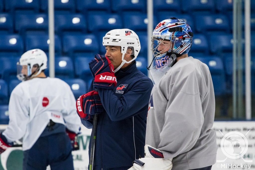 Detroit native John Vanbiesbrouck watches drills at the Warren Strelow Camp in Plymouth. (Photo by Michael Caples/MiHockey)
