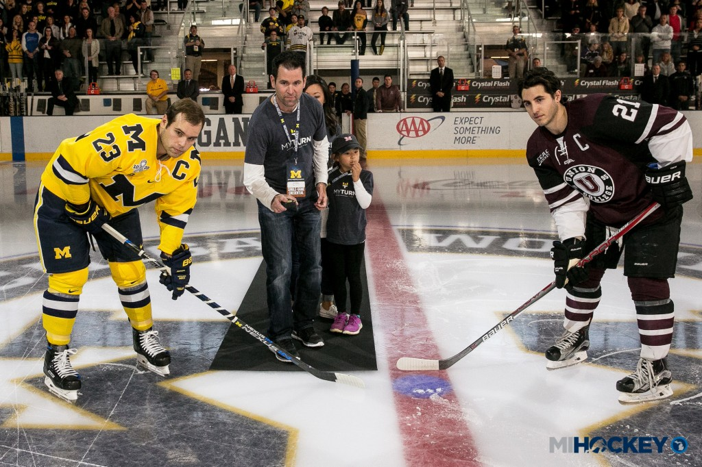 Scott Matzka dropping the puck before the Wolverines' game on Oct. 8. (Photo by Andrew Knapik/MiHockey)