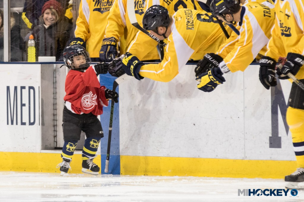 Matzka's son, Owen, celebrates his goal on Marty Turco to kick off the second period. (Photo by Michael Caples/MiHockey)