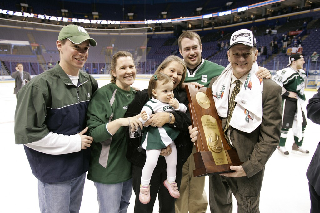 Comley (right) with his family after MSU's national title in 2007.